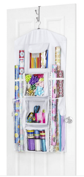 There are so many gift wrap organizing products out there to help you tame your gift wrap, like this hanging organizer. See more at Refined Rooms!