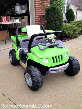 Child's Jeep Wrangler Electric car displayed in a garage sale.