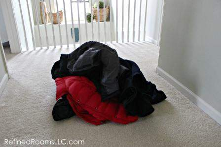 Spring coat closet declutter Winter Coat Pile