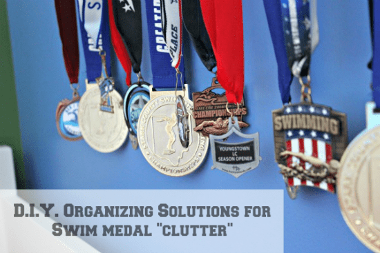 Organizing Swim Award Medals by creating a medal display shelf with Ikea Ribba Picture Ledge @ Refinedroomsllc.com