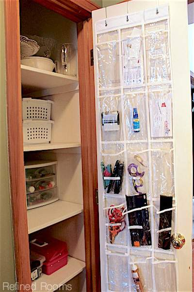 using an over the door shoe organizer to maximize storage space @ refinedroomsllc.com