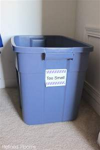 plastic bin used to store outgrown clothing.