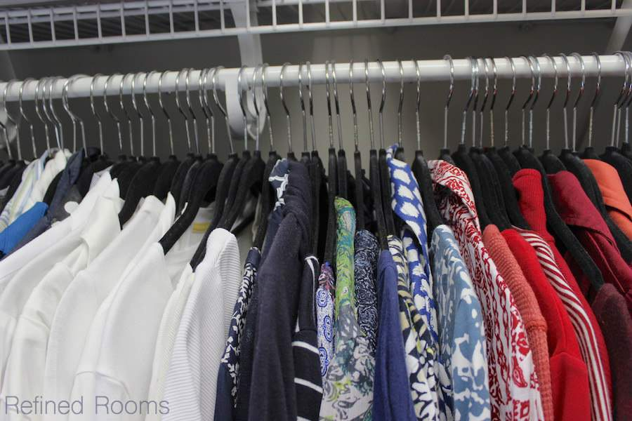 Using slimline huggable hangers to maximize hang space and enhance visual appeal in your master closet organization project | Refined Rooms