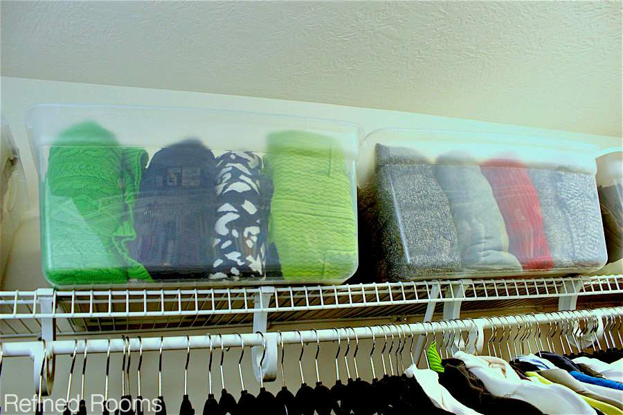Using clear storage boxes for sweater storage in your master closet organization project | Refined Rooms