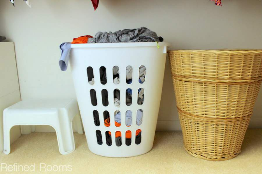 Use the area under the hang space for laundry hampers in the master closet | Refined Rooms