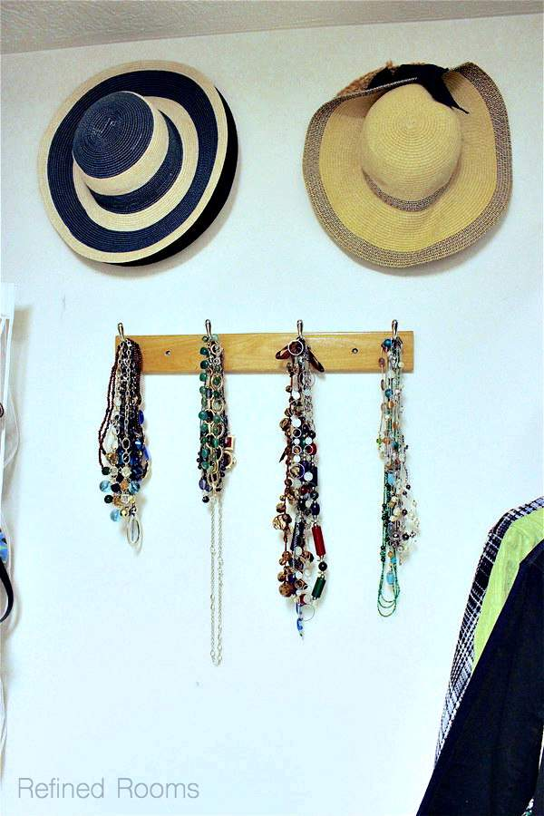 Using hooks to hang accessories in your master closet organization project | Refined Rooms