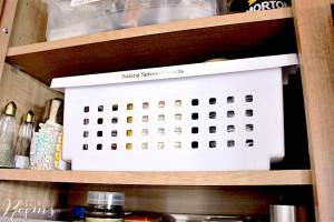stackable storage bin used to organize kitchen cabinet.