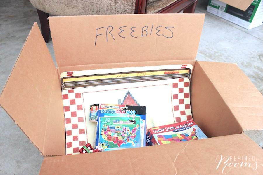 Box of free items at a garage sale.