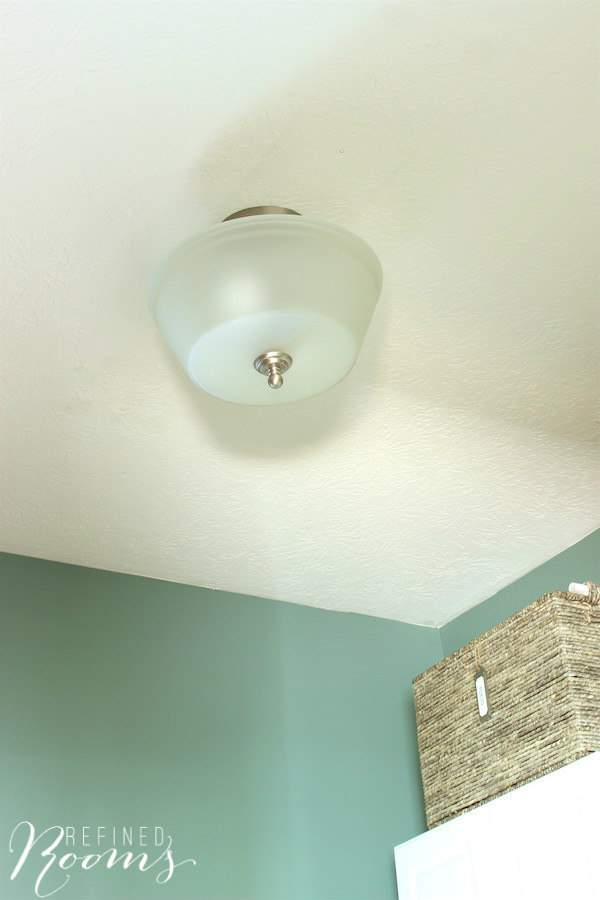So excited to share my laundry room makeover reveal! One of my favorite additions is the new semi-flush mount ceiling fixture
