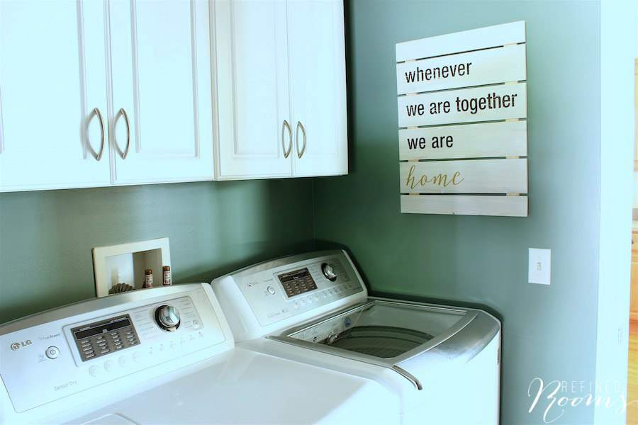 So excited to share my laundry room makeover reveal! This simple plank wall art is the perfect addition