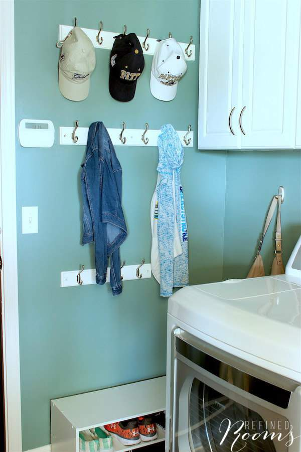So excited to share my laundry room makeover reveal! Come see how new flooring, lighting, storage and simple wall decor completely transformed this space