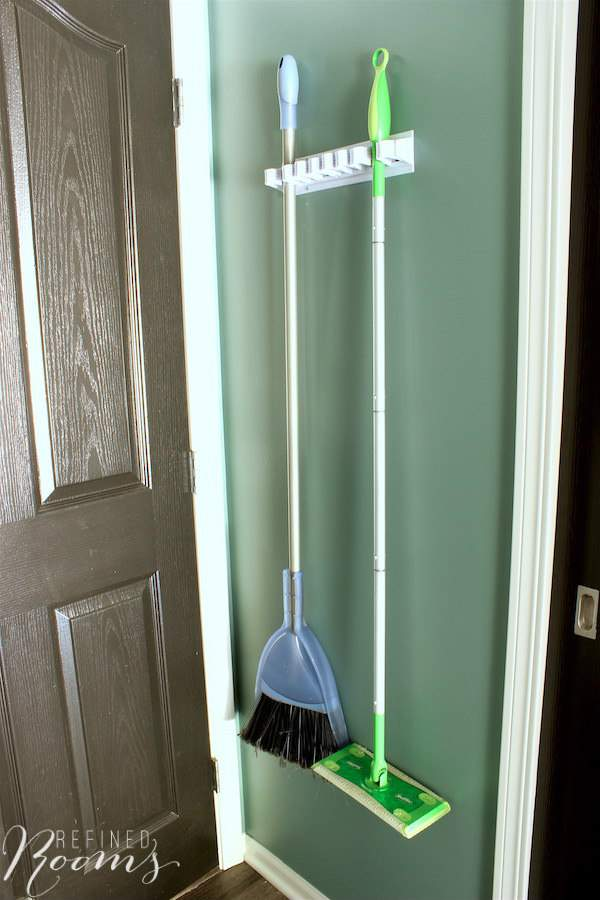 So excited to share my laundry room makeover reveal! It's the simple additions to this room that make me so happy, like this new utility organizer that keeps our brooms & mops organized