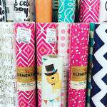 collection of colorful gift wrap rolls.