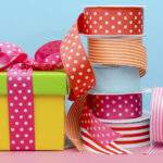 colorful wrapped gifts and ribbon.