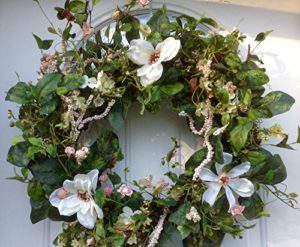 On the hunt for a new spring wreath? Check out this round up of 15 stunning options, including this white magnolia wreath