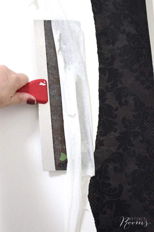 Check out this DIY tutorial: Learn how to remove wallpaper with hot water