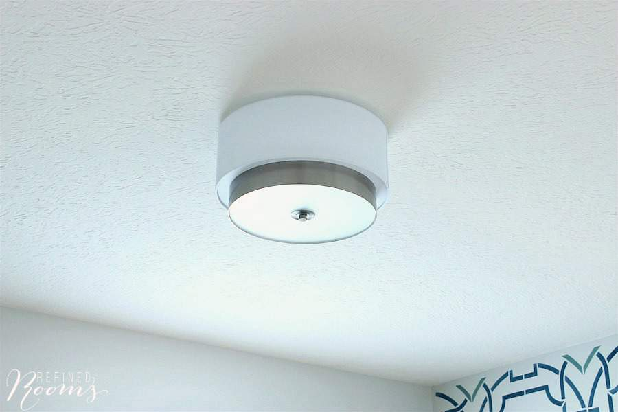 I installed this modern flush light fixture as part of our homework/craft room makeover in the One Room Challenge