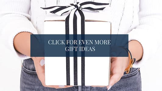 "woman holding a gift - text overlay ""Click for even more gift ideas""."