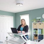 woman in home office at standing desk