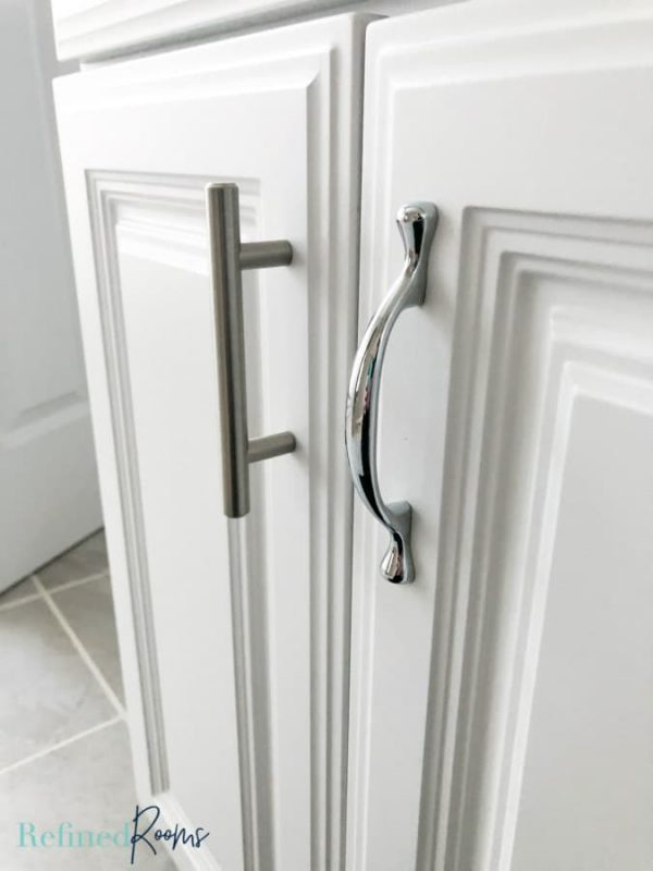 updated cabinet hardware in a bathroom\.
