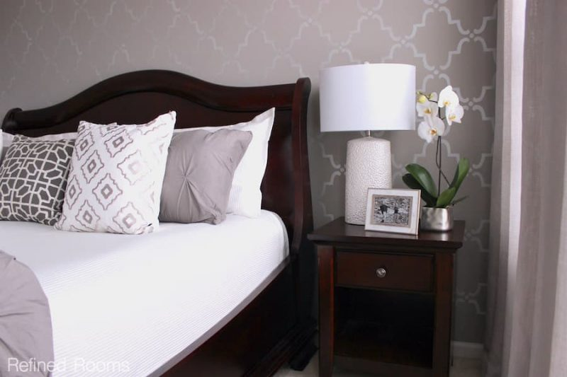 a gray modern bedroom with stenciled focal wall.