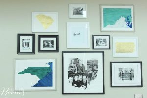 a gallery wall of photos and art work - stuck at home diy home project