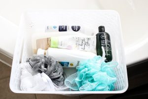 basket of bathroom toiletries to hide for house showing