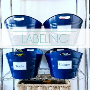 "labeled bins organized on garage shelf - text ""labeling""."