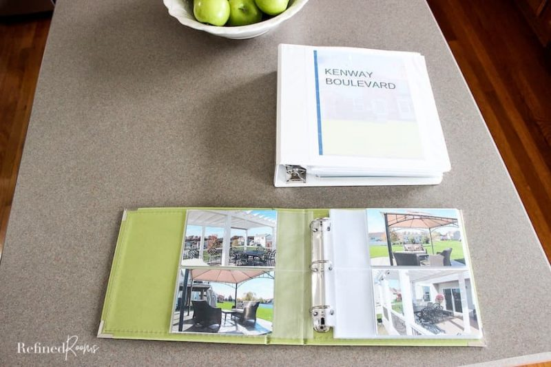 photo book of home exterior on kitchen island.