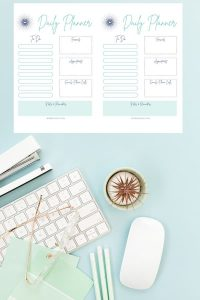 Half-size daily planner printable on blue desktop.